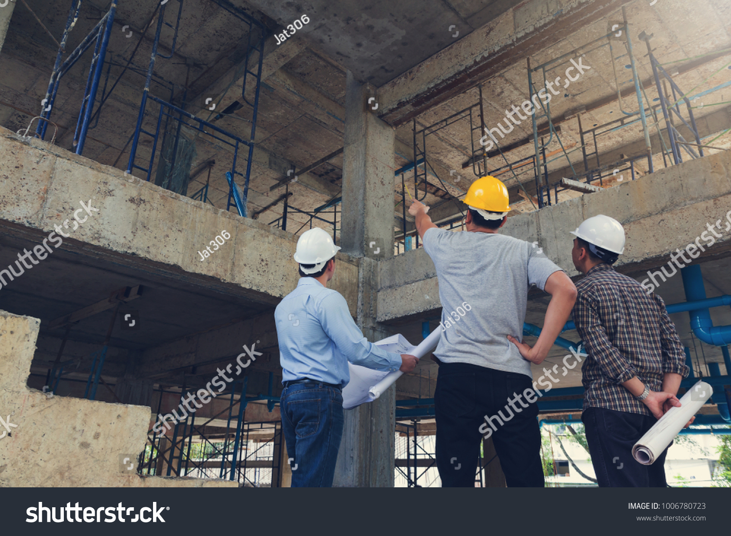 Construction concept of Engineer and Architect working at Construction Site with blue print #1006780723