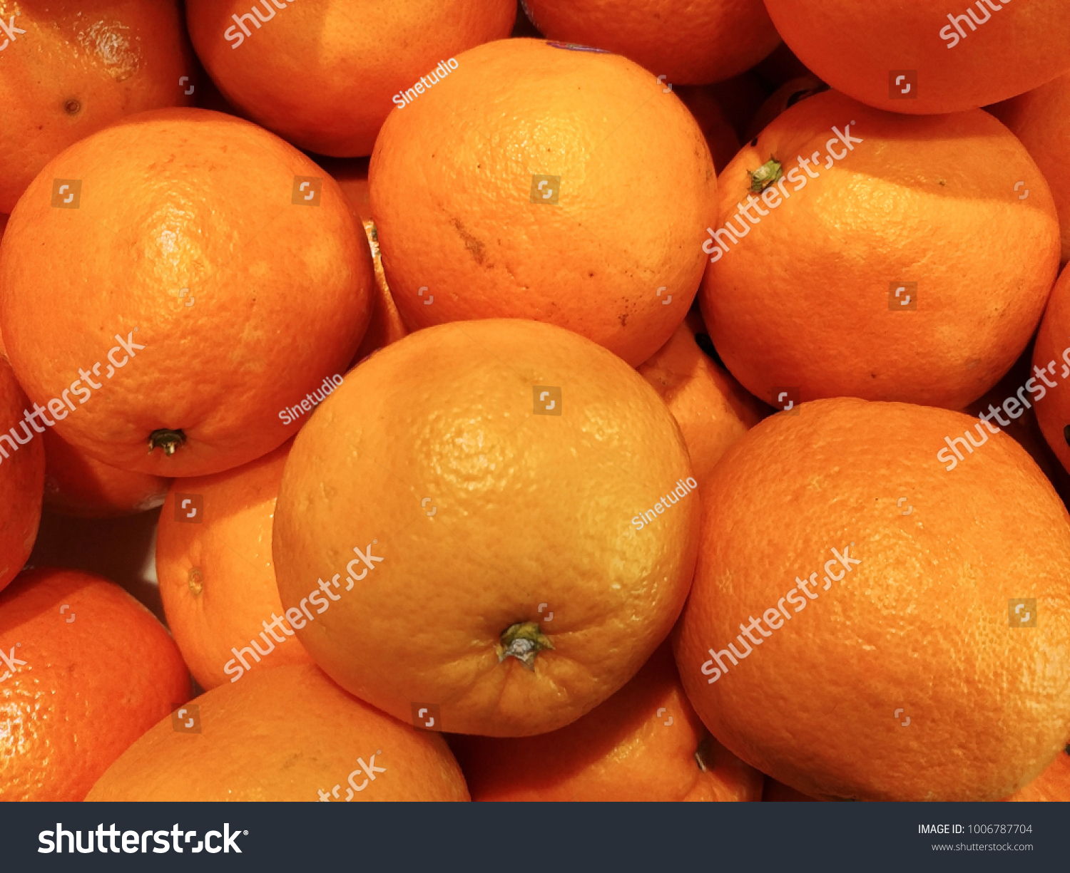 ... are in season in the supermarket during Chinese New Year. Fresh fruit good for better health. Fresh China Navel mandarin orange background wallpaper.