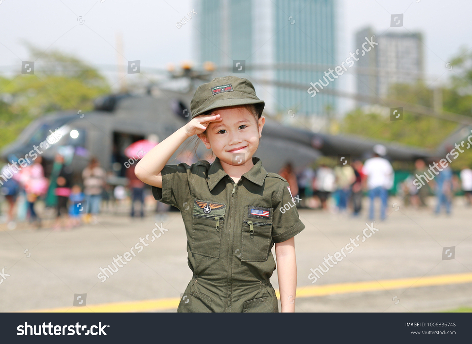 low cost b481e 5cc73 Portrait of asian child girl wearing airforce pilot suit against blur  helicopter background.