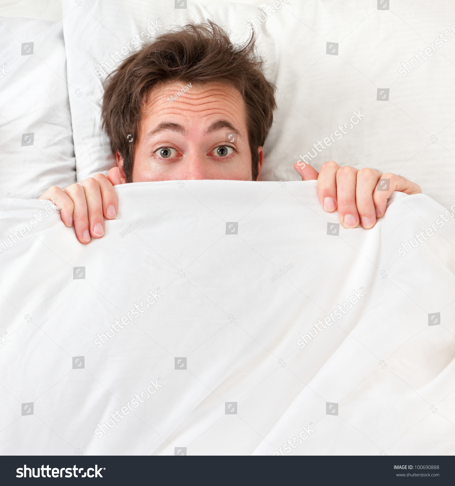 Funny bed sheets - Scared Man Hiding In Bed Under The Sheets Funny Concept Image With Young Caucasian Male