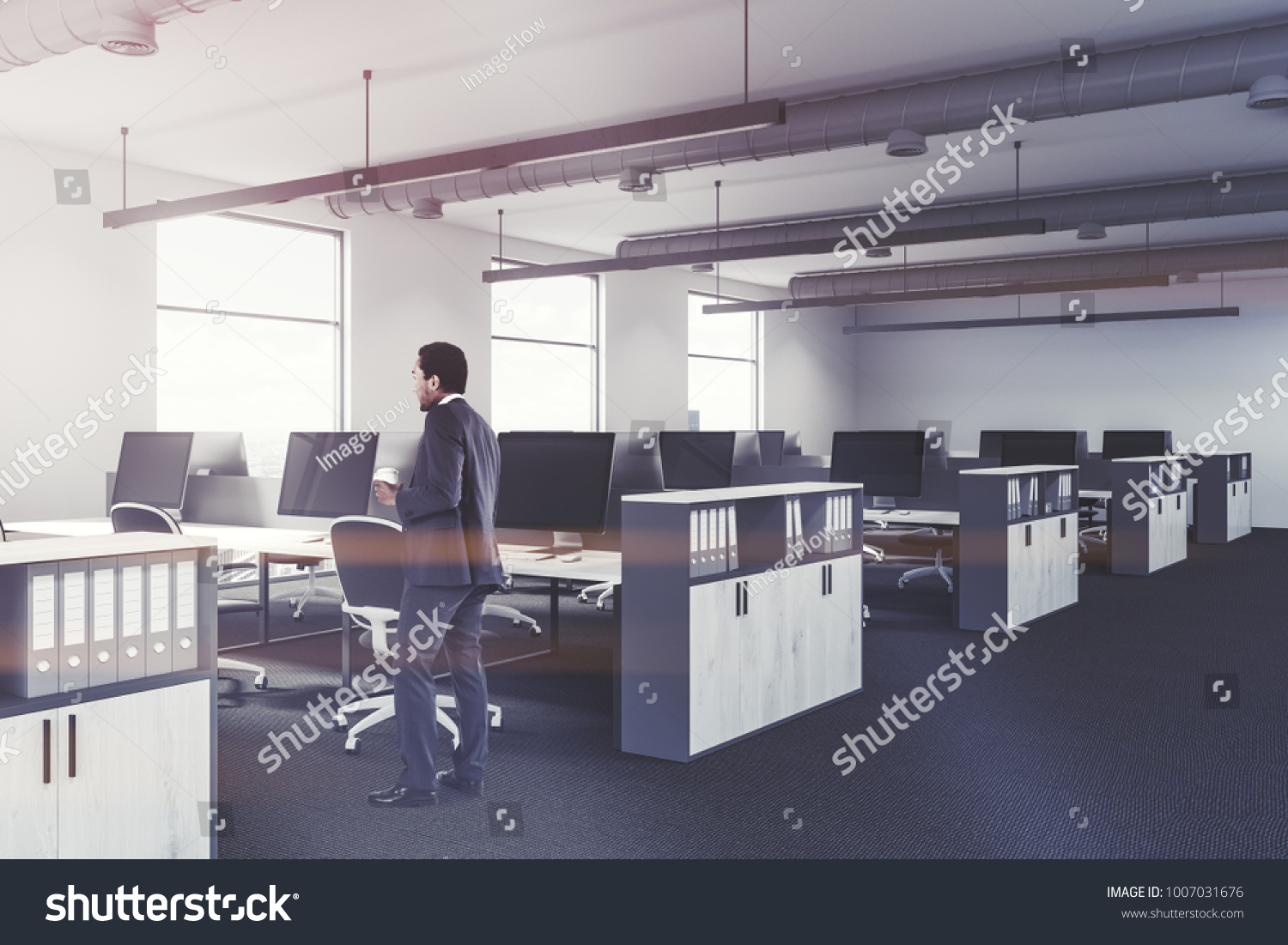 Modern office interior with white walls, large windows, white desks on office tables, office counters, office lamps, office bookcases, office stools, office kitchen, office furniture, office beds, office lobby, office footrest, office reception, office desks, office accessories, office trash can, office employees, office sofa sets, office computers, office couch, office pens, office cubicles,