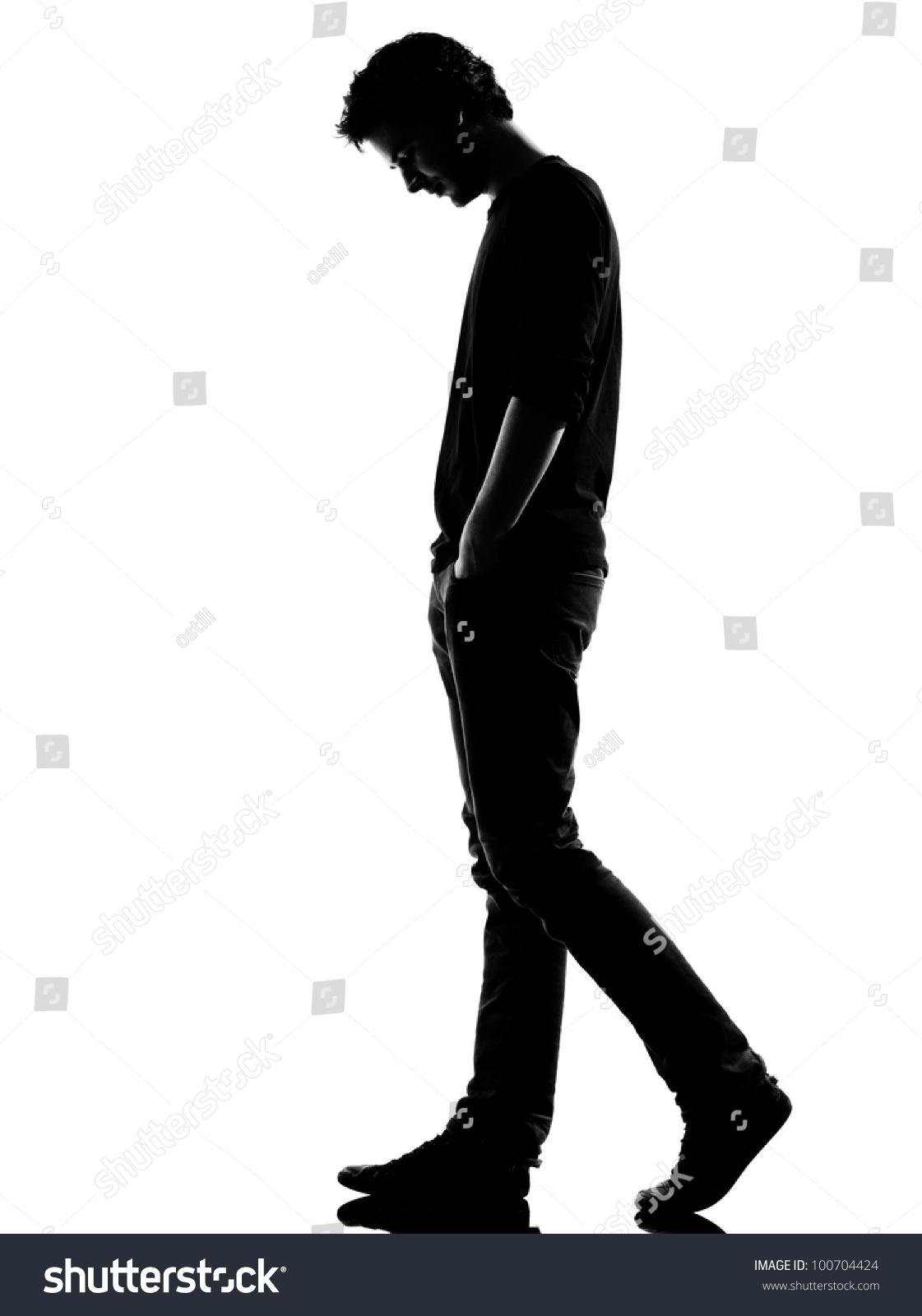 Young man sad walking silhouette studio stock photo royalty free young man sad walking silhouette in studio isolated on white background altavistaventures Gallery