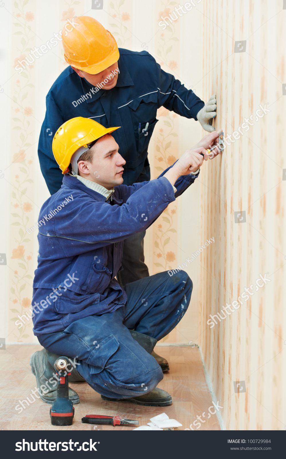 Two Electrician Workers Wiring Cable Light Stock Photo Edit Now Wall Outlet With Switch At And Or Power Socket Installation Work