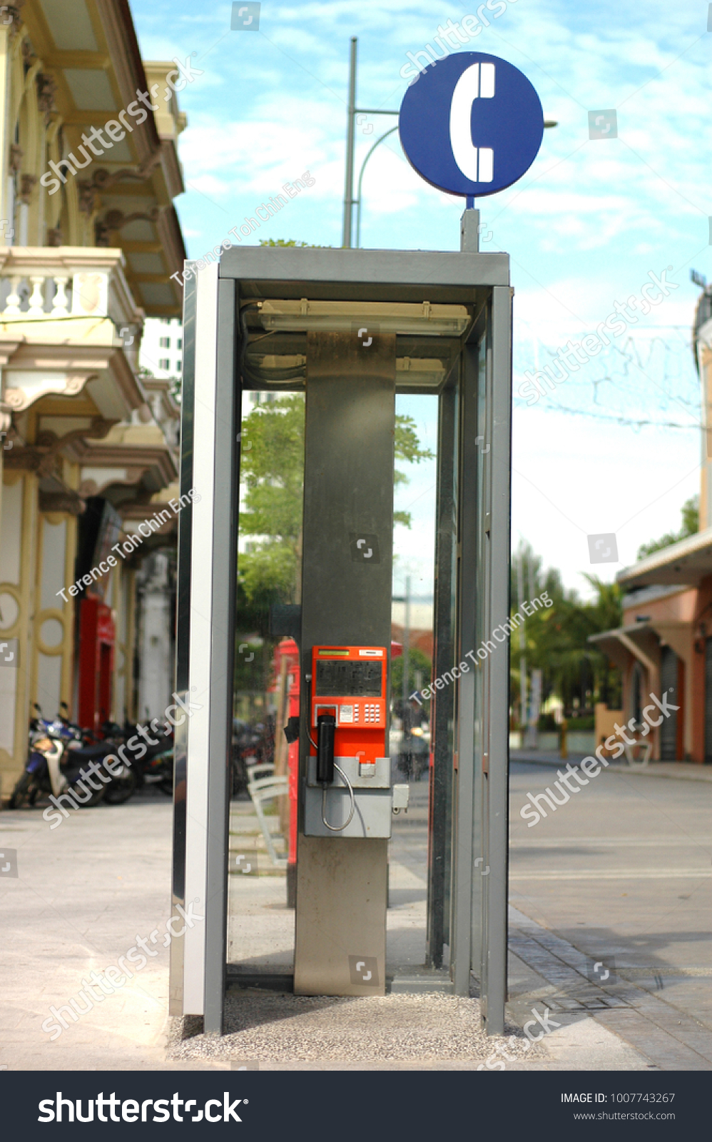 Typical Classic Orange Pay Phone Shade Stock Photo (Edit Now