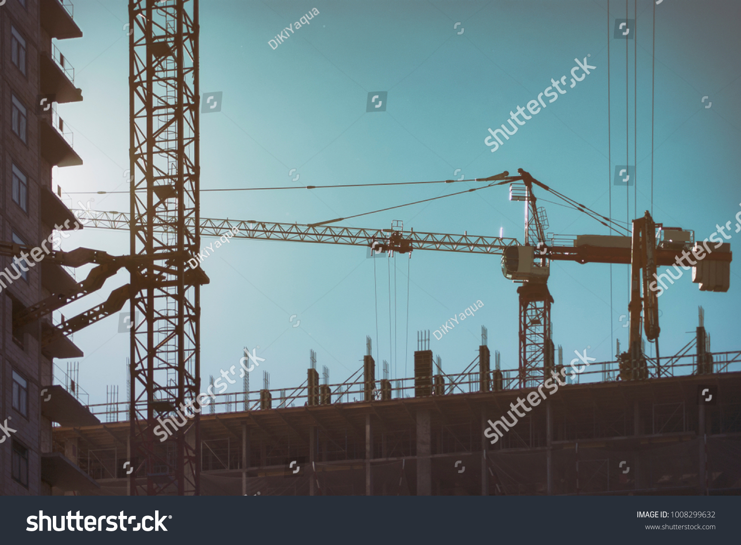 Industrial Construction Cranes Silhouettes Over Sunset Ez Canvas Electrical Wiring Installation In A Multistory Building