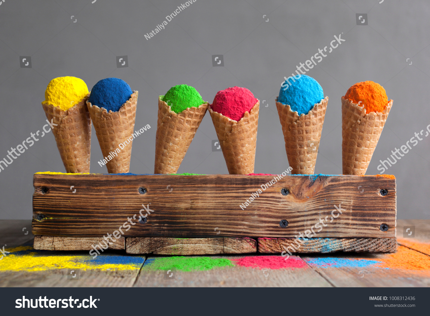 Bright colours in shapes of ice cream scoops in cones for Indian holi festival. Colorful gulal (powder colors) for Happy Holi. #1008312436 - 123PhotoFree.com