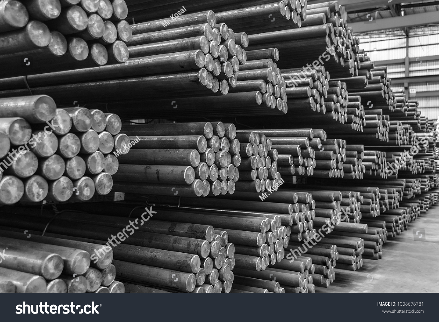 Rows of Steel Round Bar storage and stacking in the warehouse for industrial construction. Black and white with Shallow focus. #1008678781