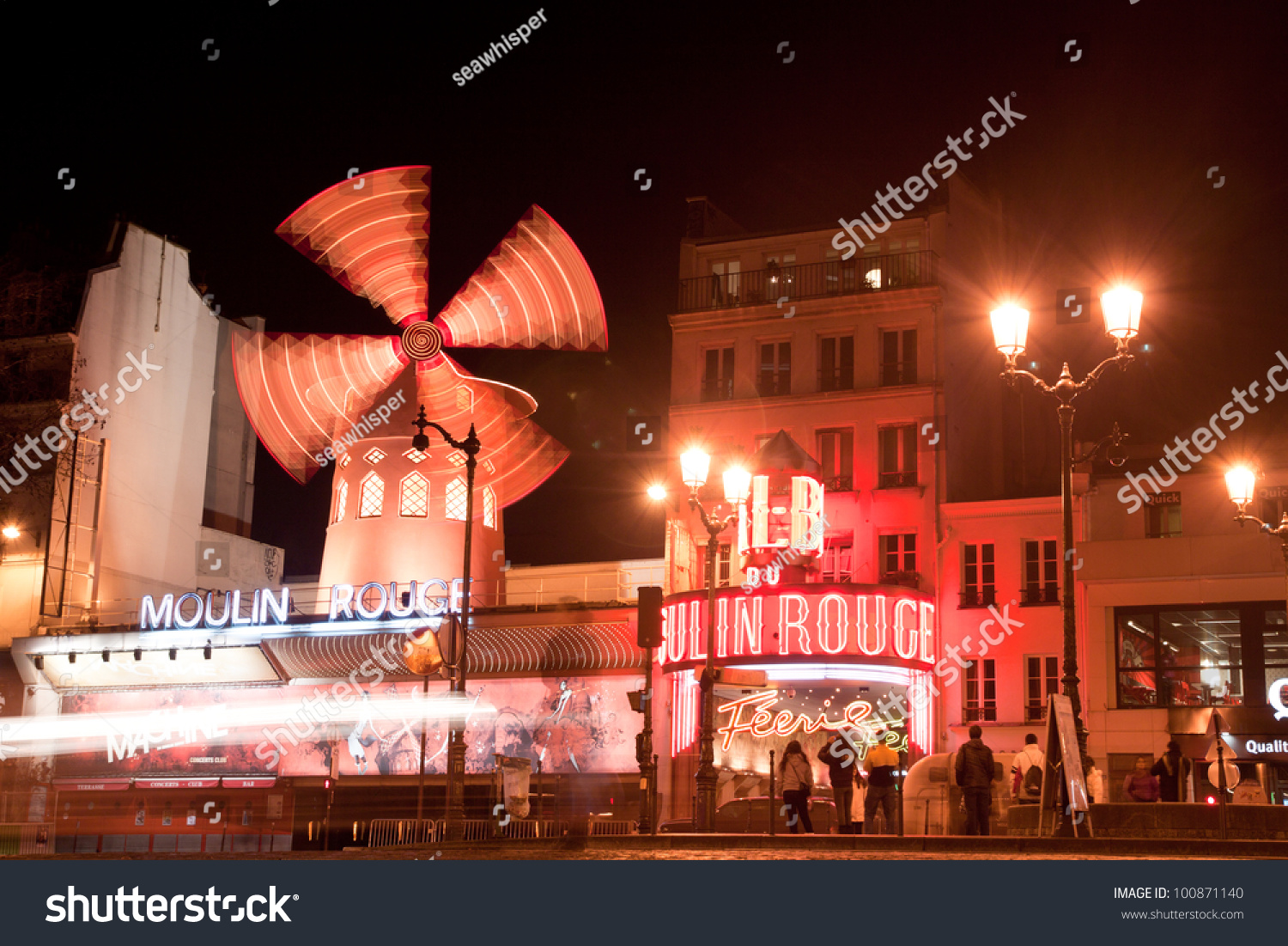 paris march 6 the moulin rouge at night on march 6 2012 in paris france moulin rouge is a. Black Bedroom Furniture Sets. Home Design Ideas