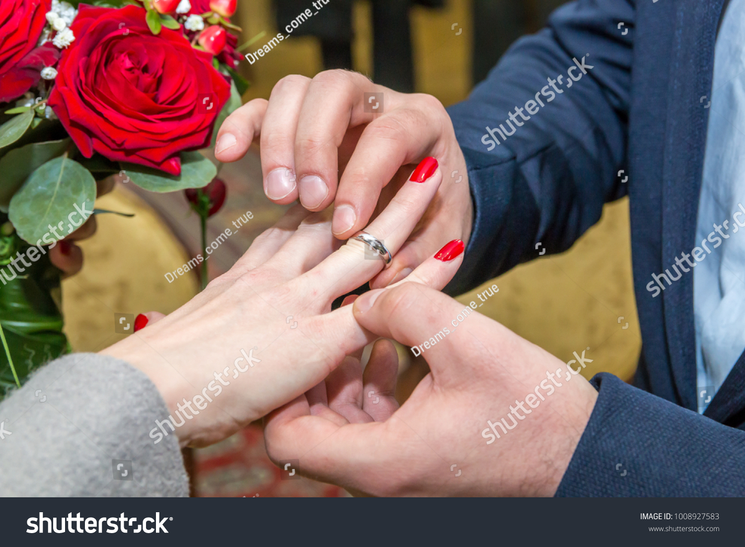 Groom Puts Wedding Ring On Brides Stock Photo (Royalty Free ...