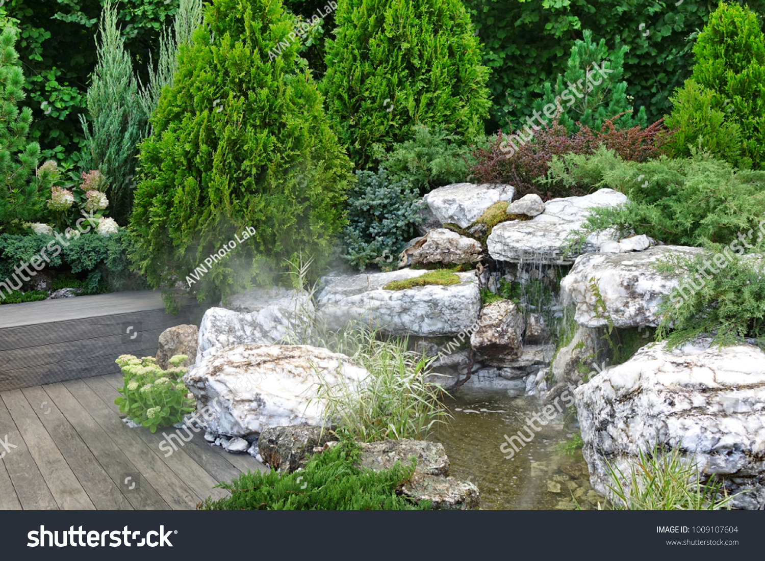 Artificial Tropical Pond Brook And Waterfall In Decorative Backyard Garden With Weatherproof Patio Floor