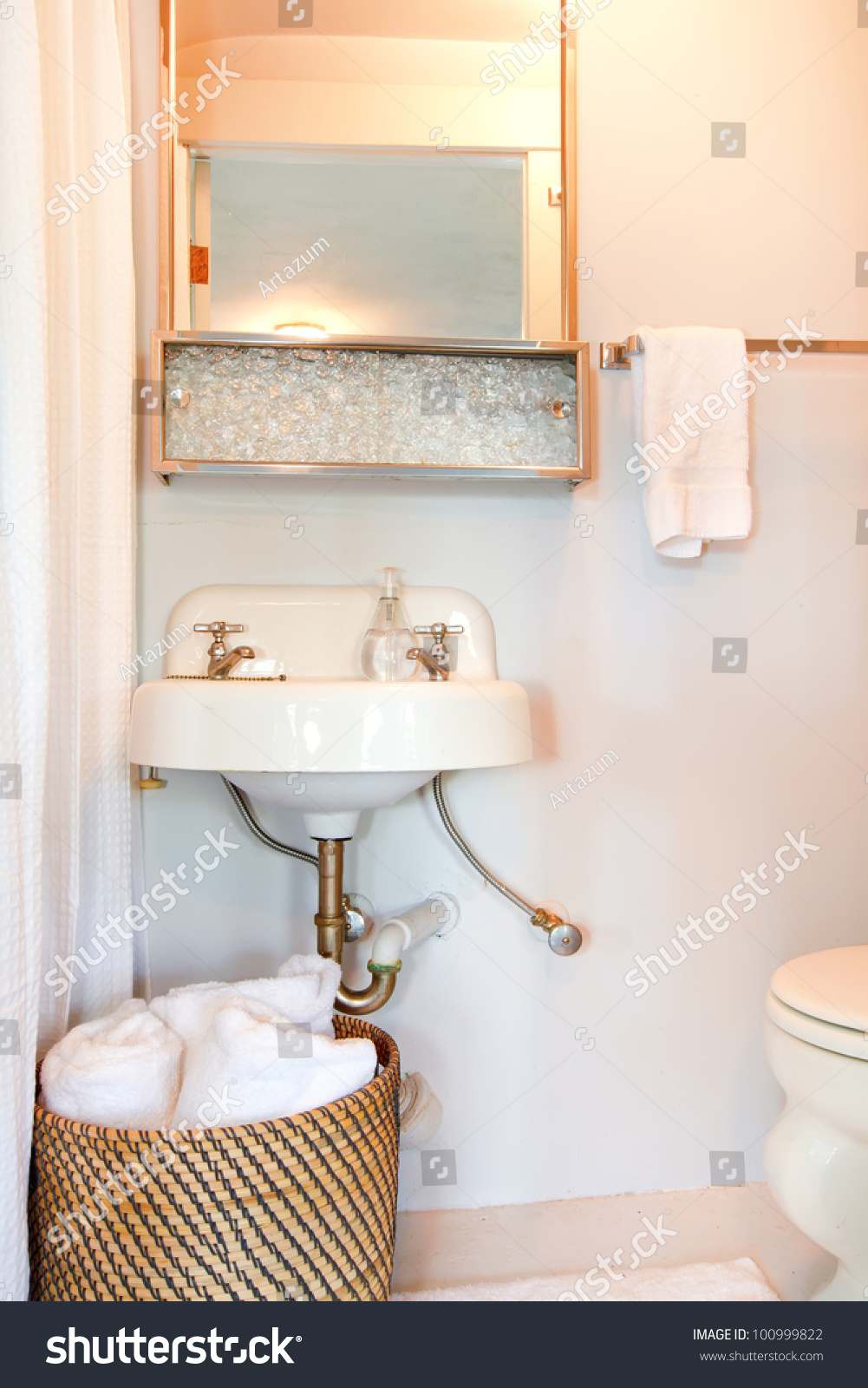 Small Blue Bathroom With Antique Sink And White Stock