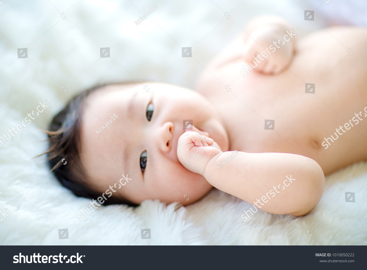 lovely baby putting his hands his stock photo (100% legal protection