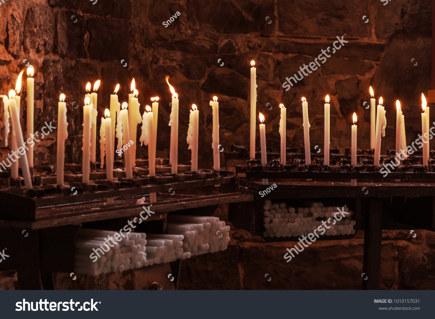 Long burning wax candles in the church