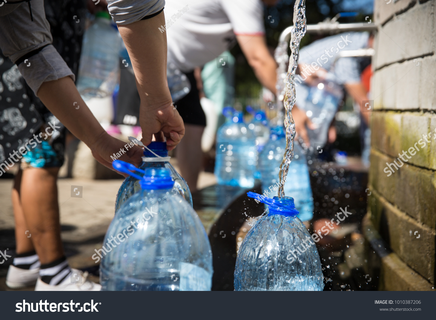 Collecting natural spring water 5 litre stock photo 1010387206 collecting natural spring water with 5 litre plastic water bottle at newlands natural spring cape town biocorpaavc