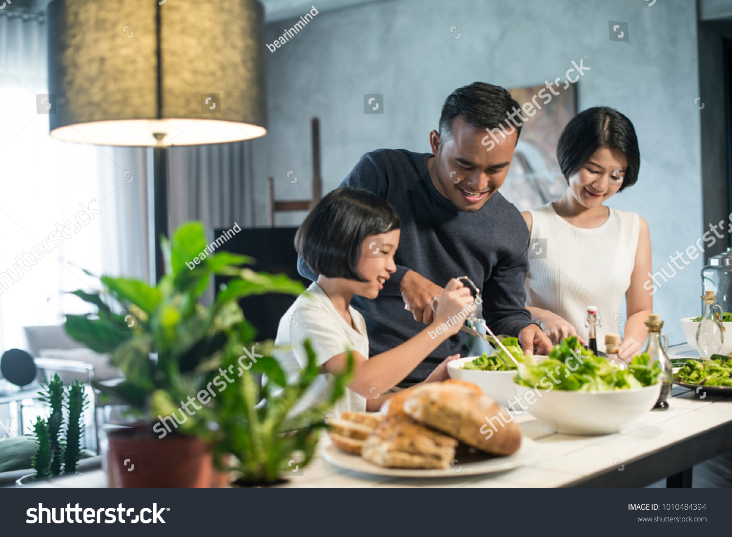 Happy Asian family preparing food in the kitchen. #1010484394