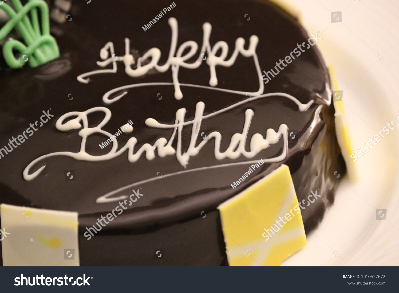 Happy Birthday Wishes On Yummy Chocolate Cake With Garnishing