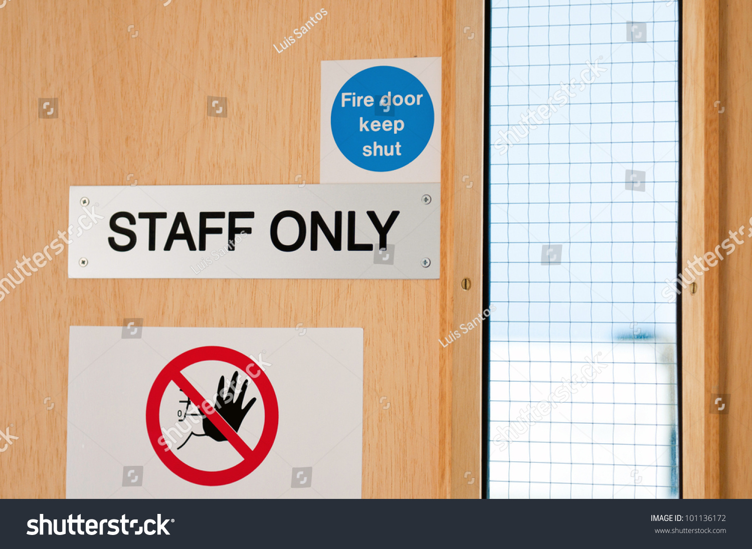 Staff only door signs outside laboratory room to assure