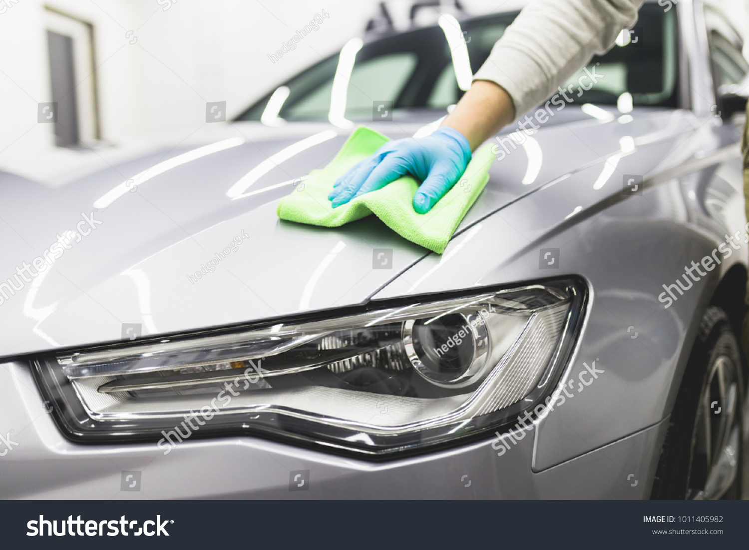 man cleaning car microfiber cloth car stock photo (edit now