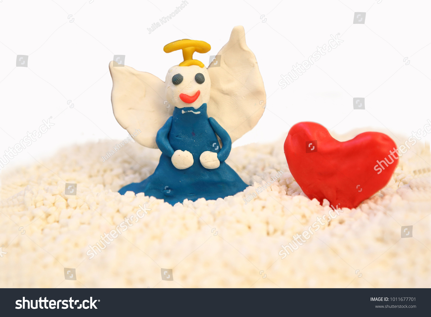 A handmade angel and red heart. Valentine's Day background. #1011677701