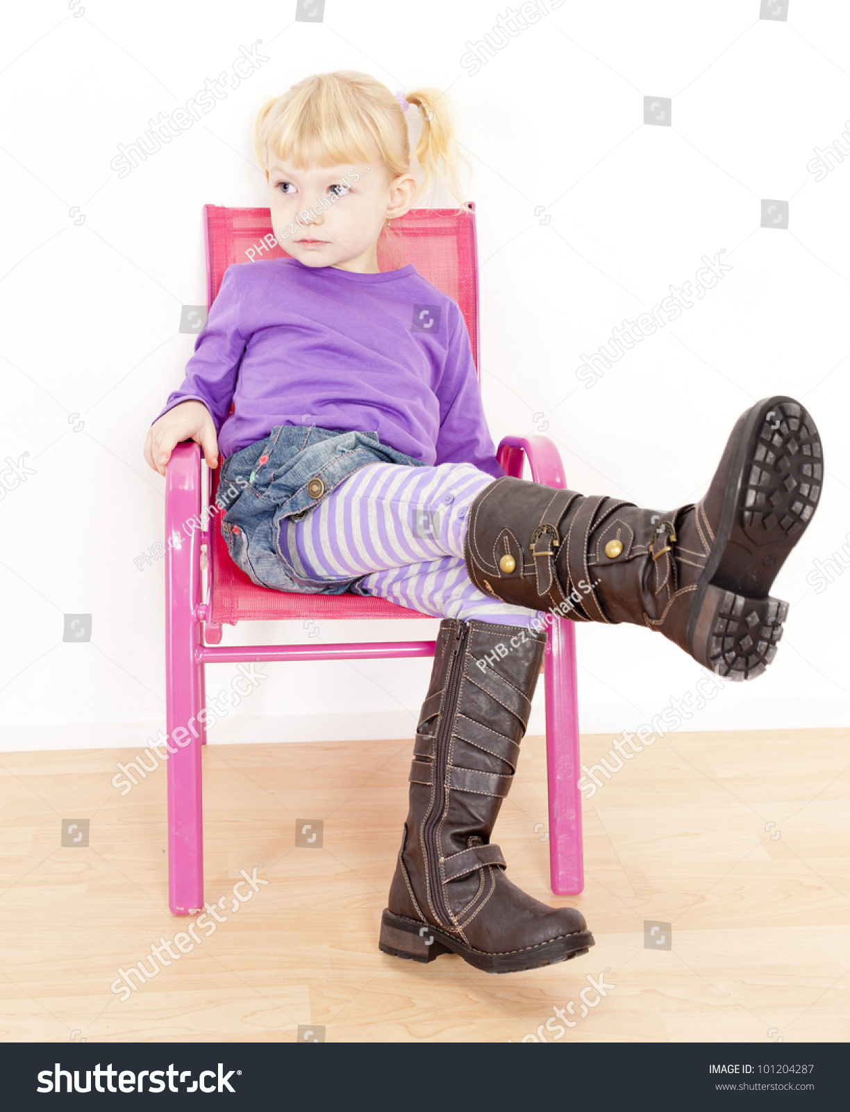 Little Girl Wearing Boots Sitting Stock