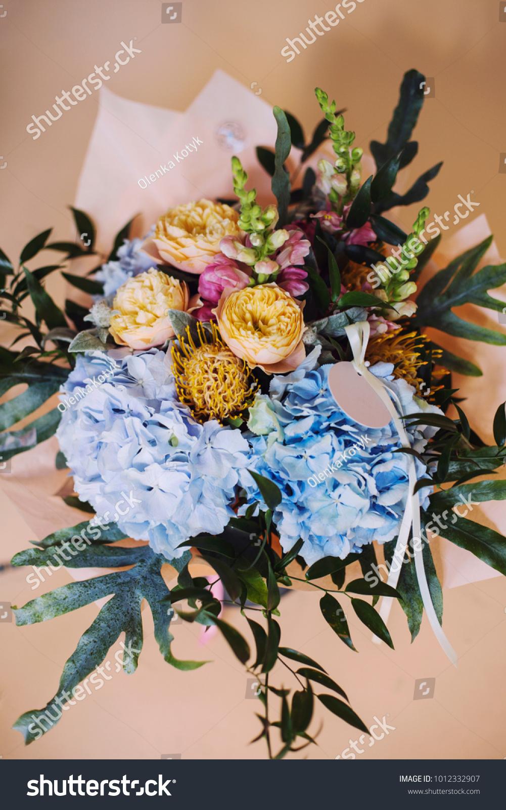 Flower bouquet composition blue hydrangea ranunculus stock photo flower bouquet composition with blue hydrangea ranunculus and peonies on yellow background izmirmasajfo