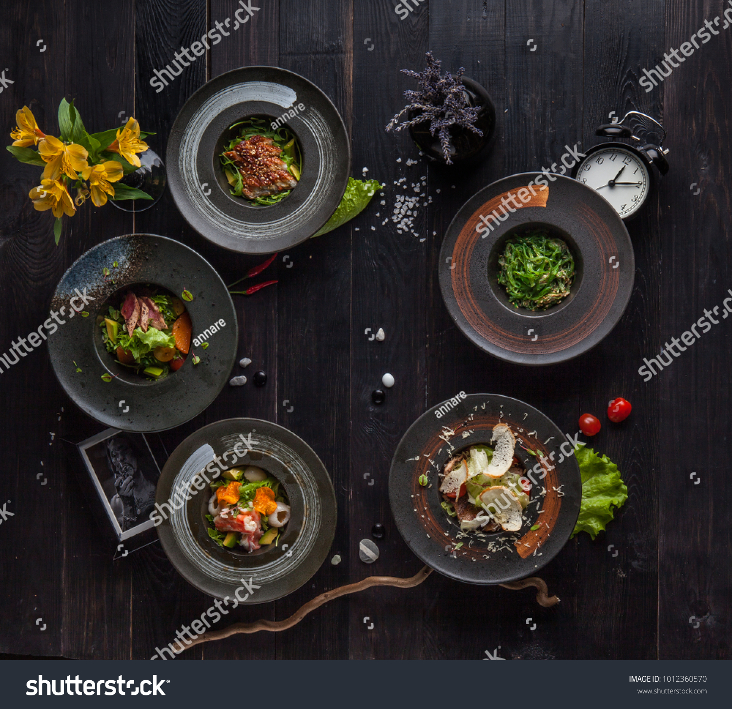 Plates Restaurant Dishes On Black Table Stock Photo Edit Now 1012360570