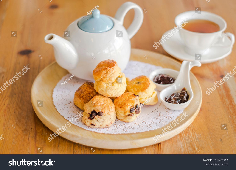 English breakfast and tea break scones on wooden table with a cup of tea. & English Breakfast Tea Break Scones On Stock Photo (Royalty Free ...