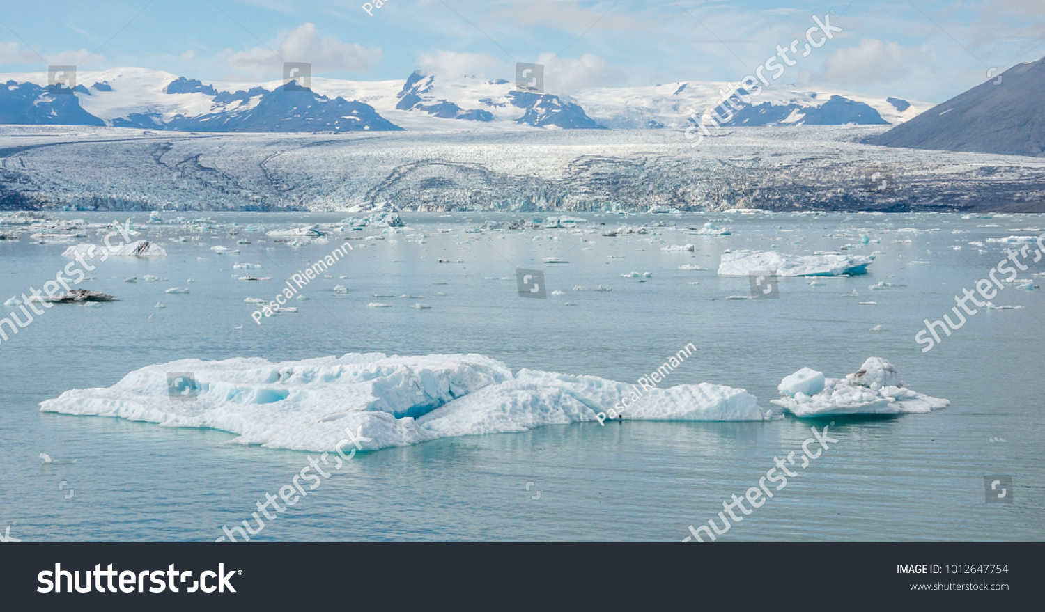 Panoramic view on the glacier lake Jokulsarlon in Iceland. In the background is the glacier, where the icebergs break off. #1012647754