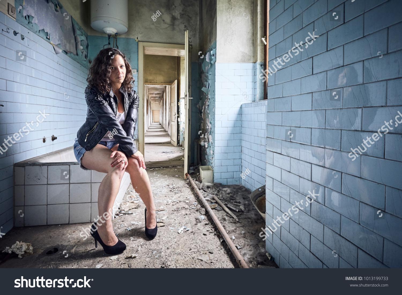Model Sitting Abandoned Bathroom On Bathtub Stock Photo (100% Legal ...