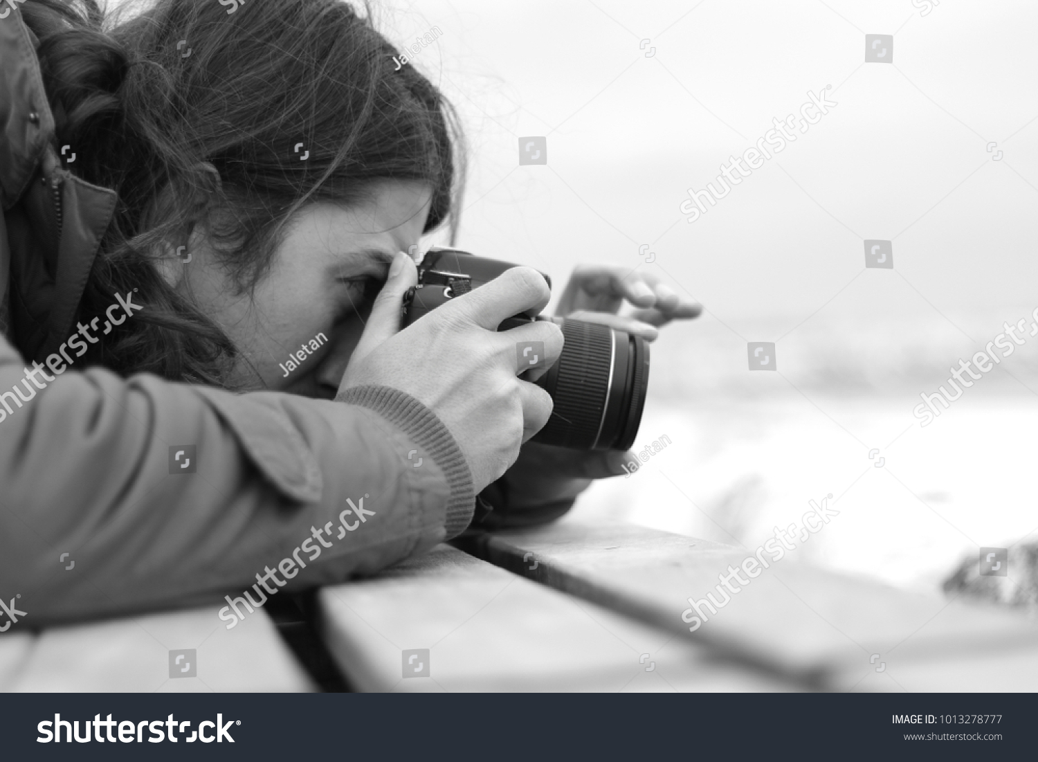The photographer man is shooting in black and white photo