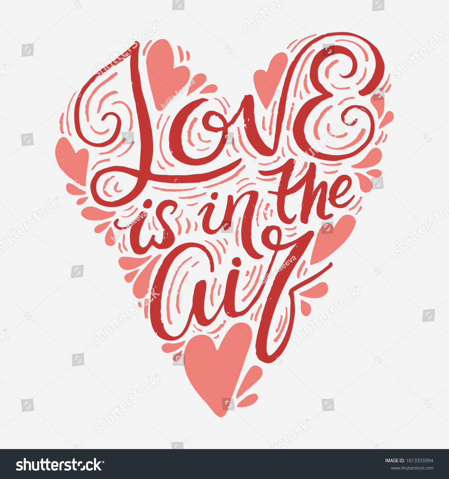 Love is in the air. Hand drawn romantic lettering in a heart shape ...