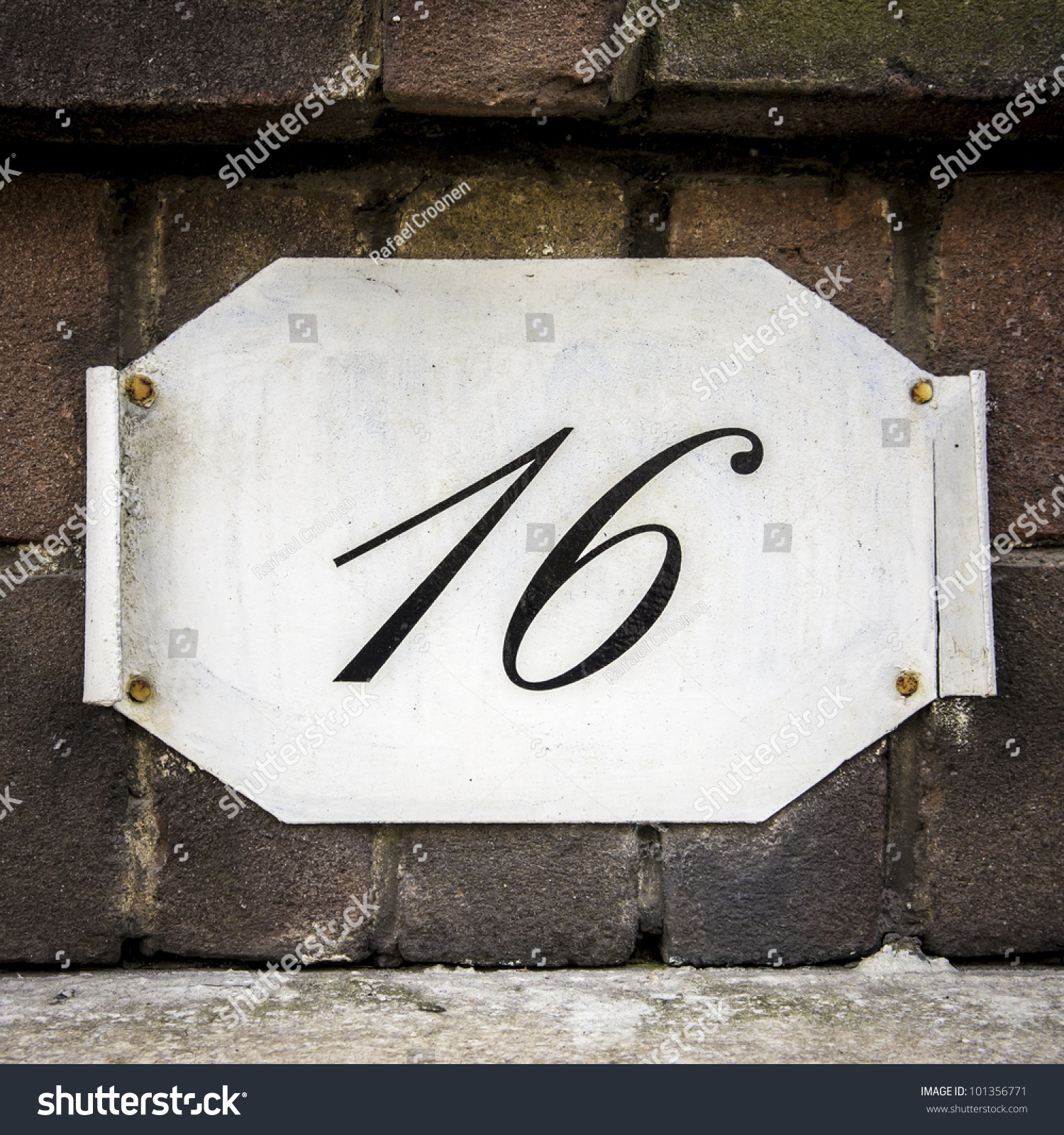 House number 16 on plate curled stock photo 101356771 for Number 16 house