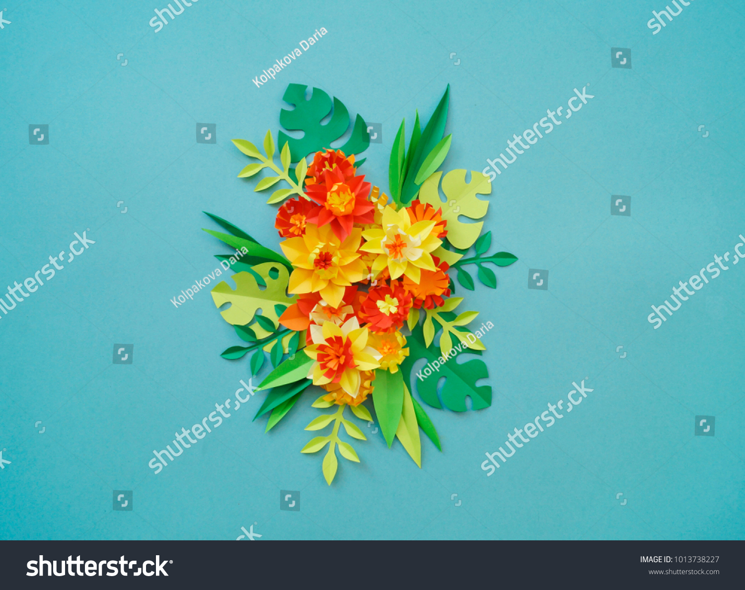 Floral arrangement paper flowers on blue stock photo royalty free floral arrangement of paper flowers on a blue background tropical flowers and leaves red mightylinksfo