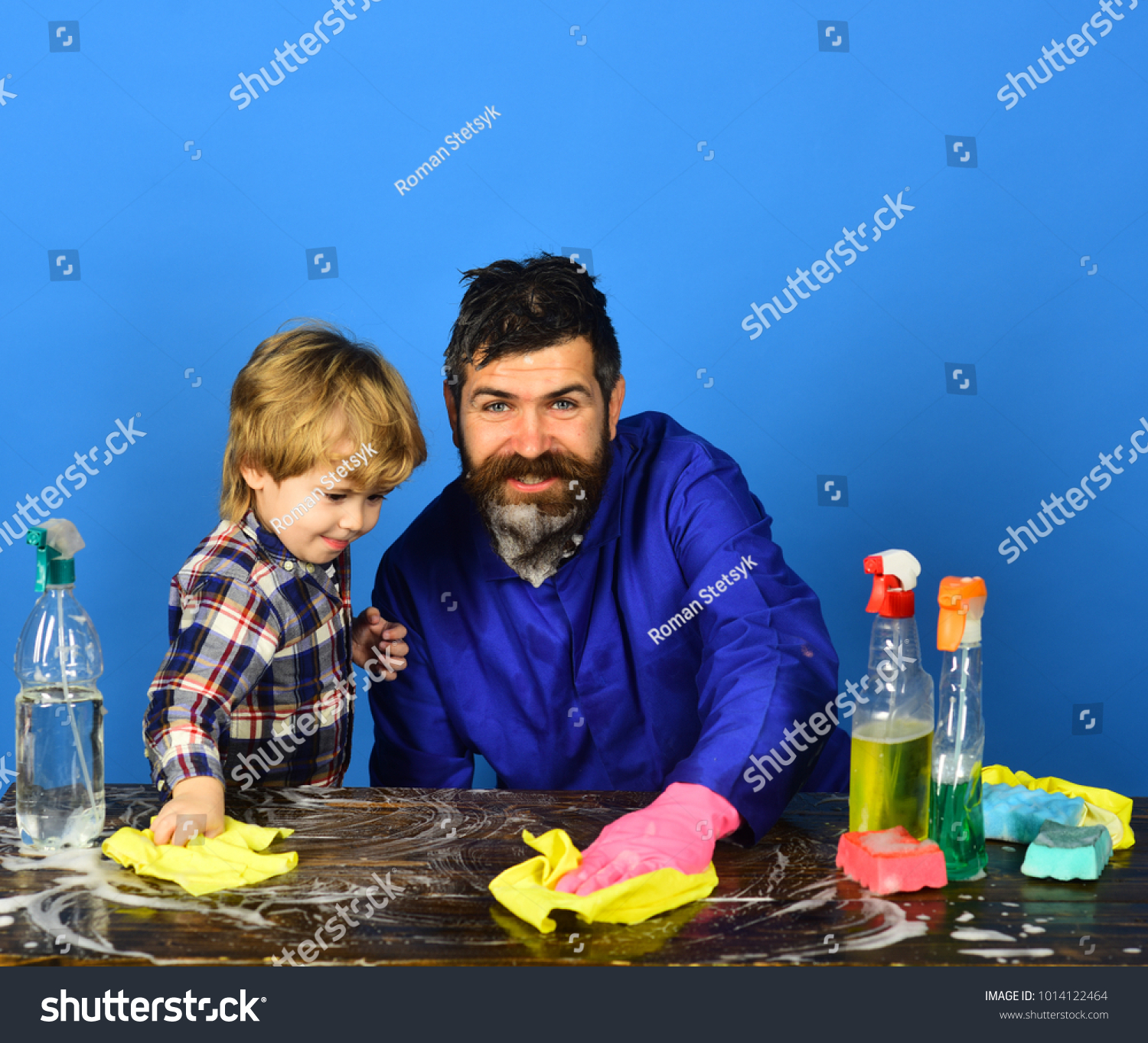 Dad With Son And Cleaning Supplies On Blue Background Man With Beard