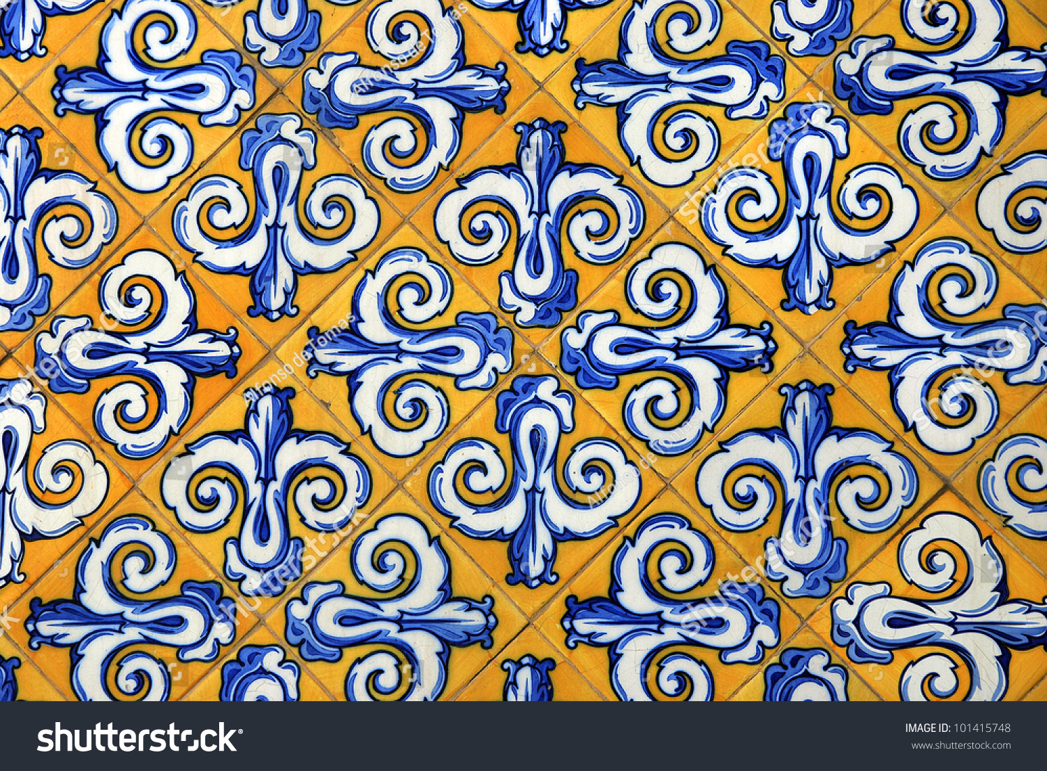 Traditional spanish ceramic tiles yellow blue stock photo traditional spanish ceramic tiles in yellow and blue dailygadgetfo Images