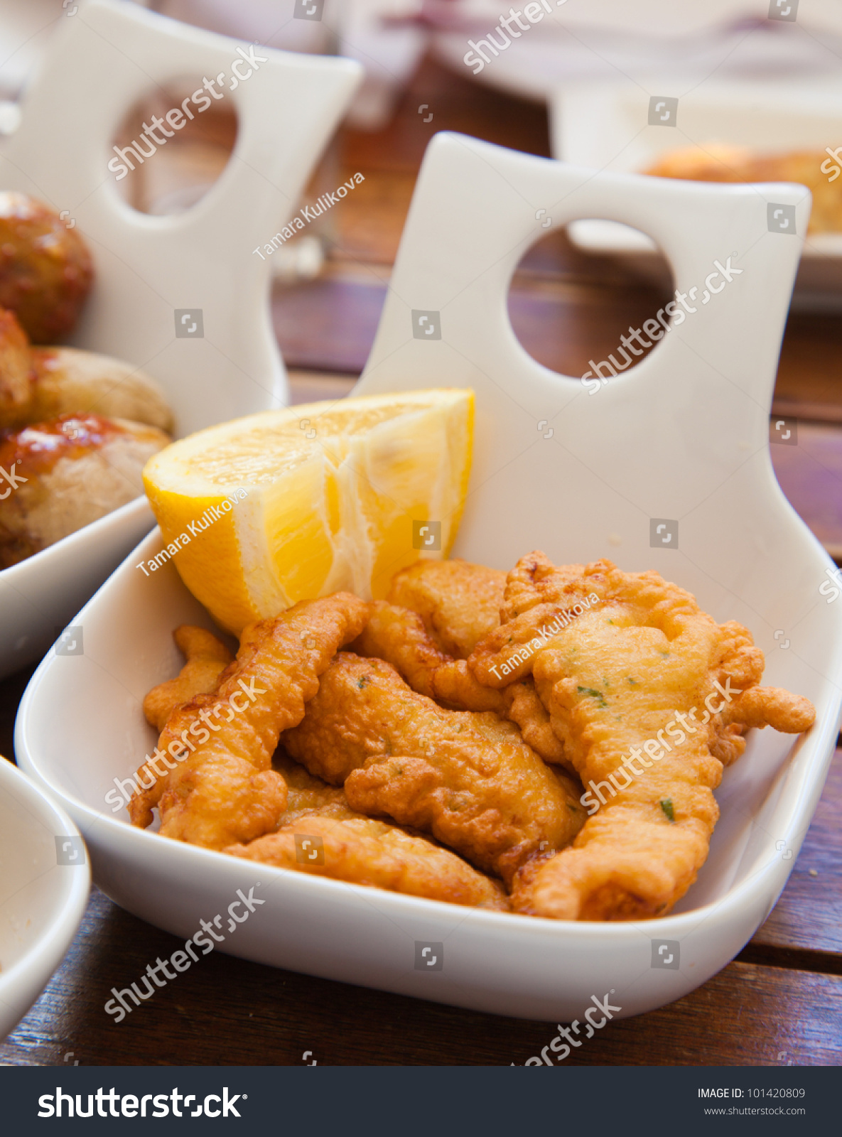 Portion of fried fish in a tapa restaurant stock photo for Fried fish restaurants
