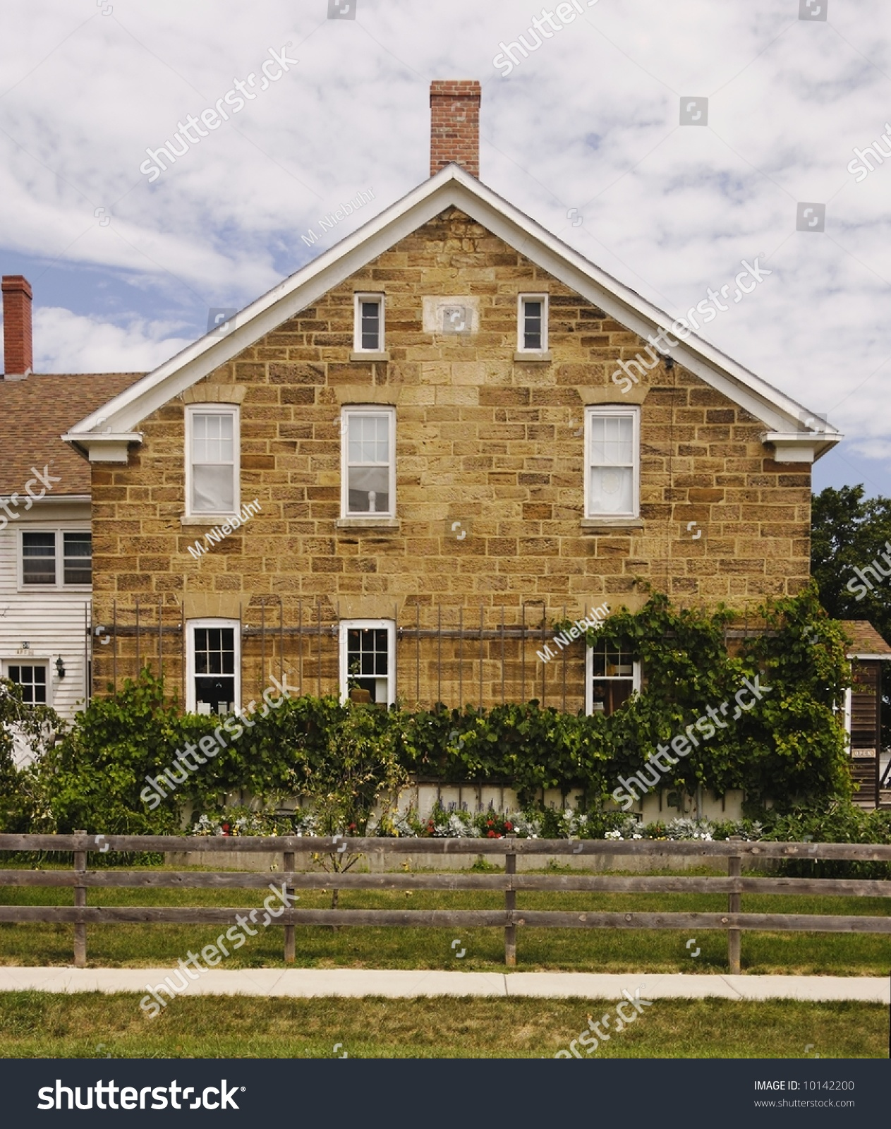 Historic Home Elevation : A historic colonial style gable roof stone facade end