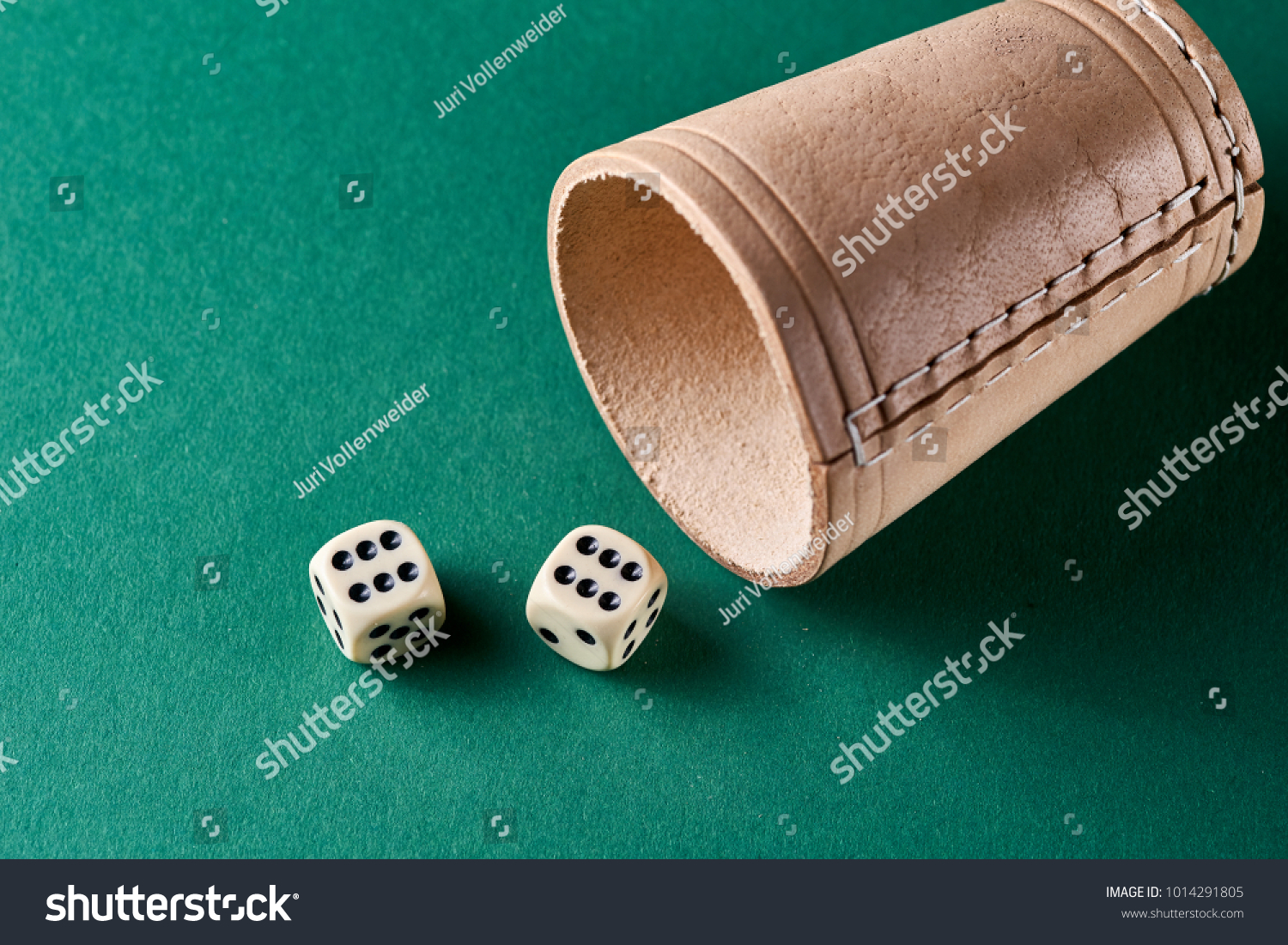 dice leather glass on green background stock photo royalty free
