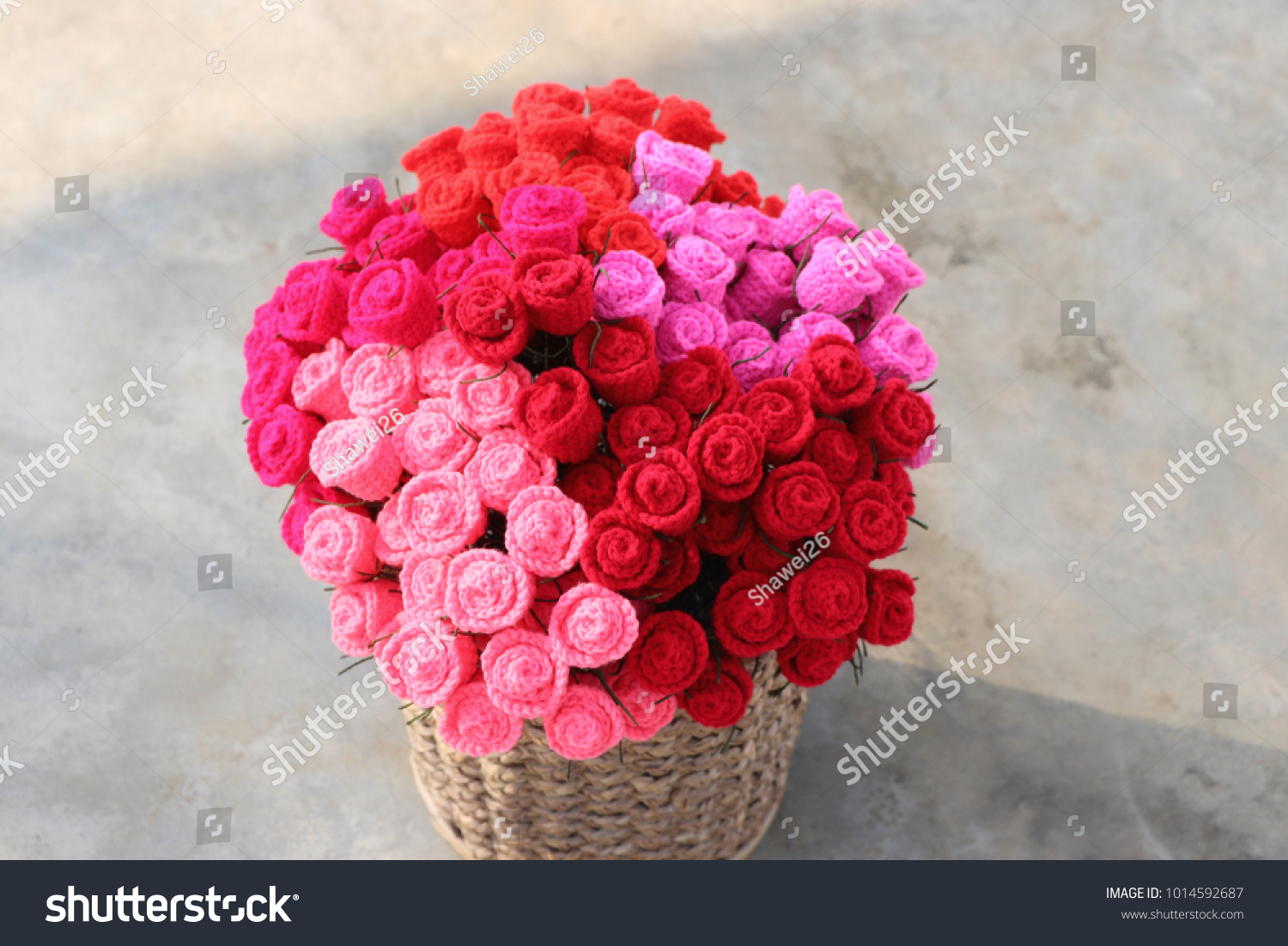 Bouquet colorful crochet roses basket on stock photo edit now bouquet of colorful crochet roses in basket on cement floor handmade crochet flowers valentines izmirmasajfo