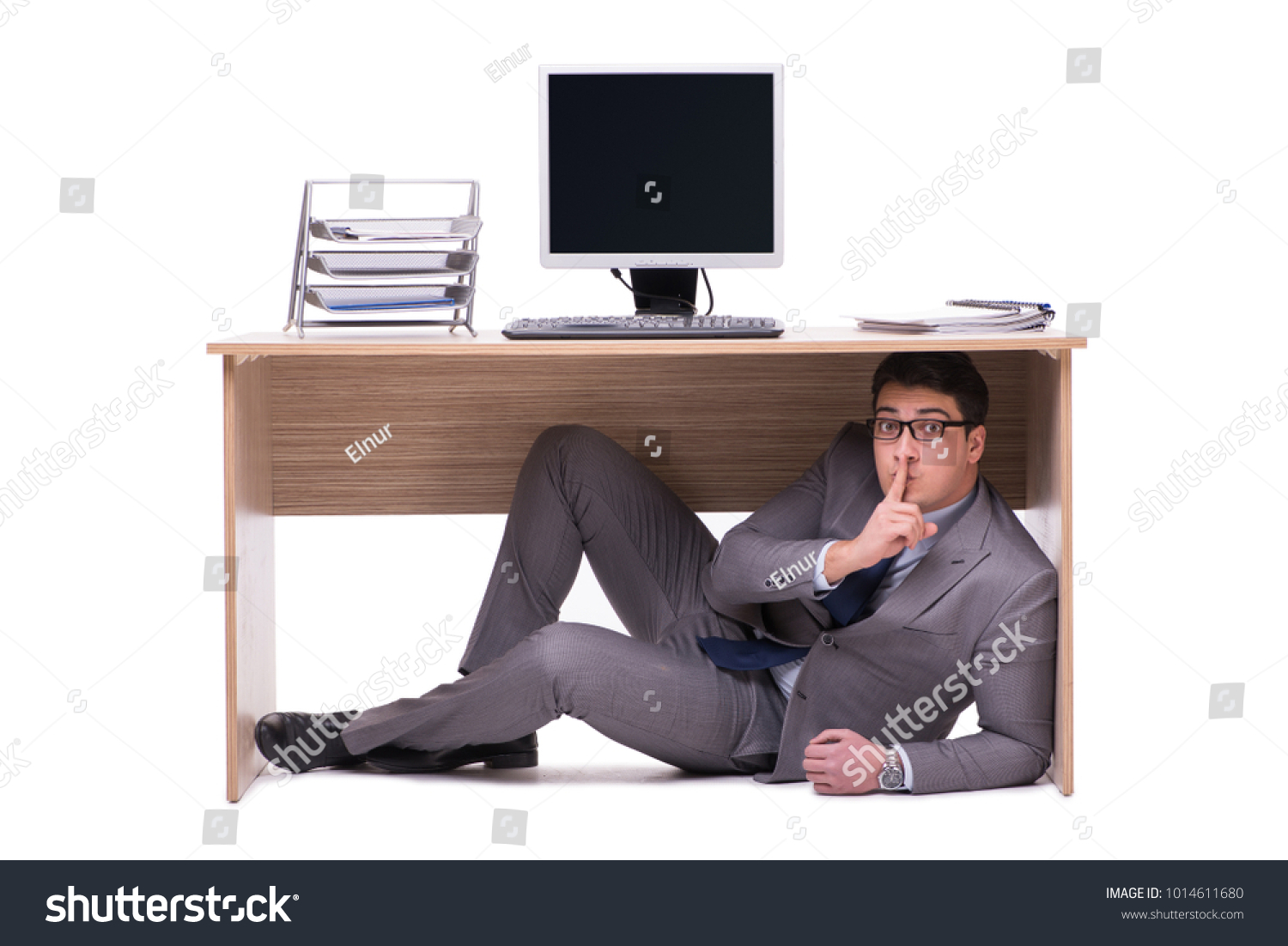 stock-photo-businessman-hiding-in-the-of