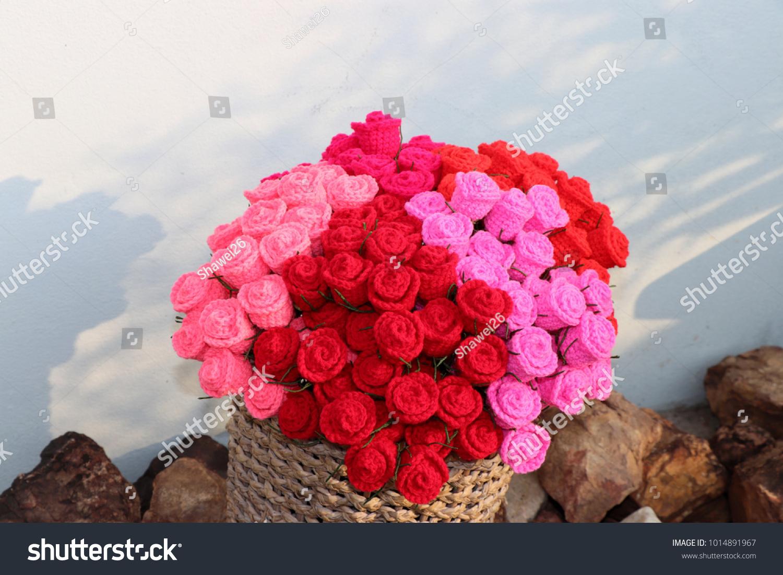 Bouquet colorful crochet roses basket on stock photo edit now bouquet of colorful crochet roses in basket on stone background handmade crochet flowers valentines izmirmasajfo