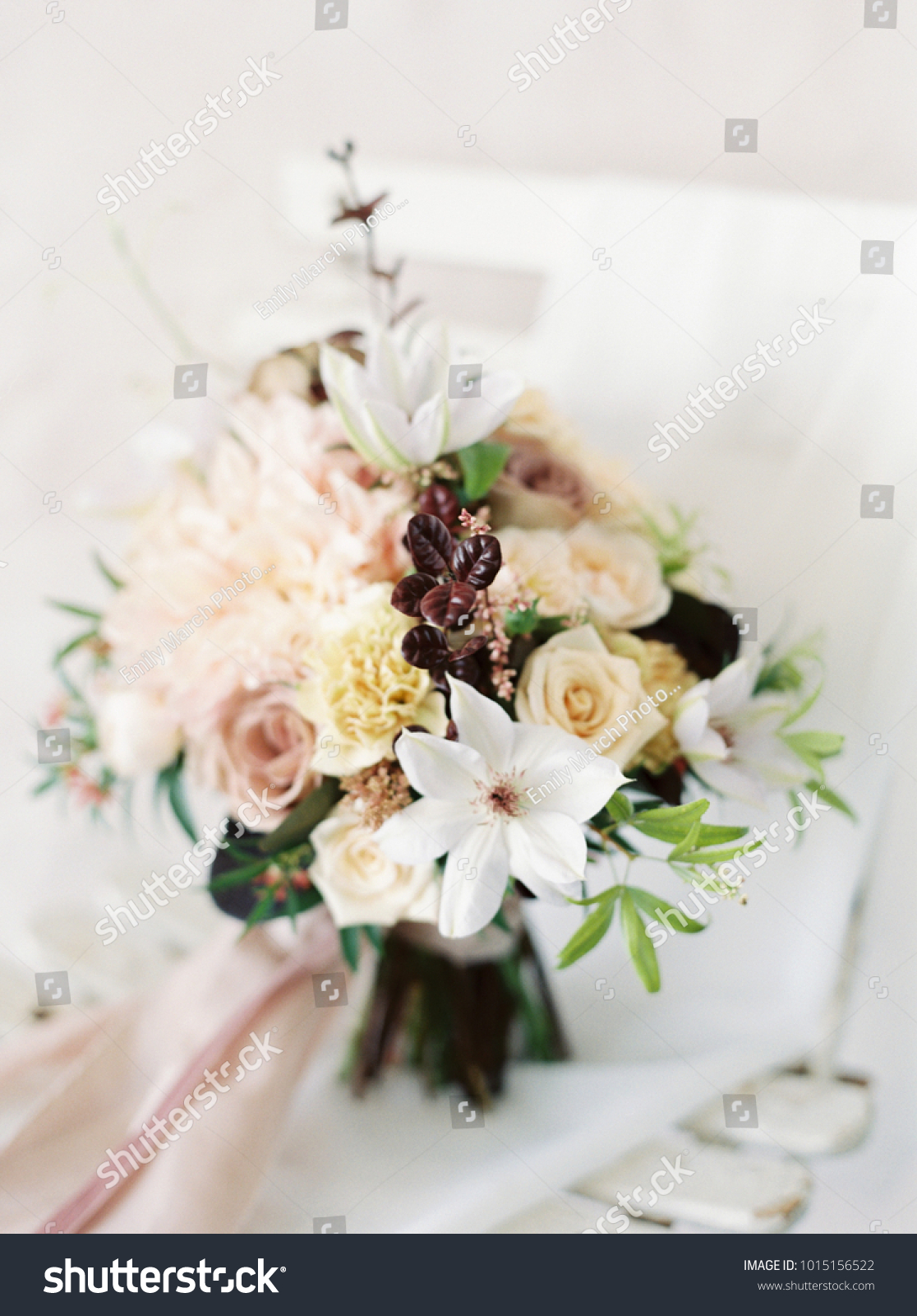 Muted wedding bouquet pink purple flowers stock photo edit now muted wedding bouquet with pink and purple flowers sits on a white bistro chair izmirmasajfo