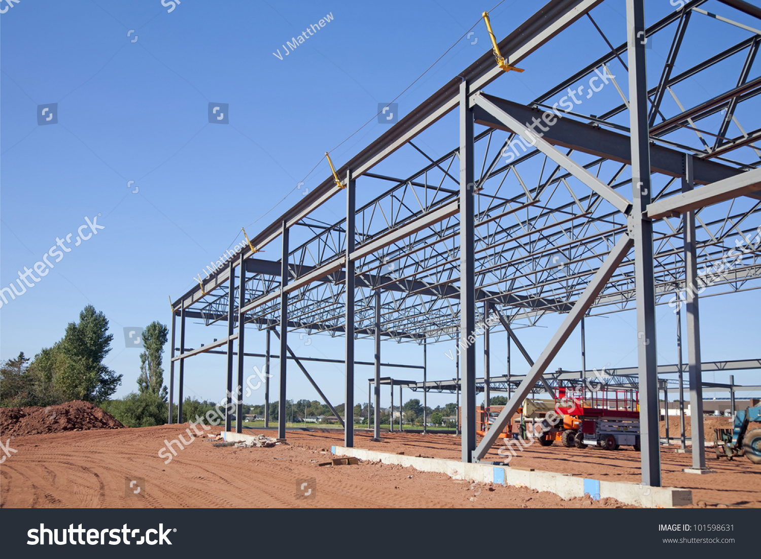 Steel Frame Work : Work site and large steel frame of a commercial