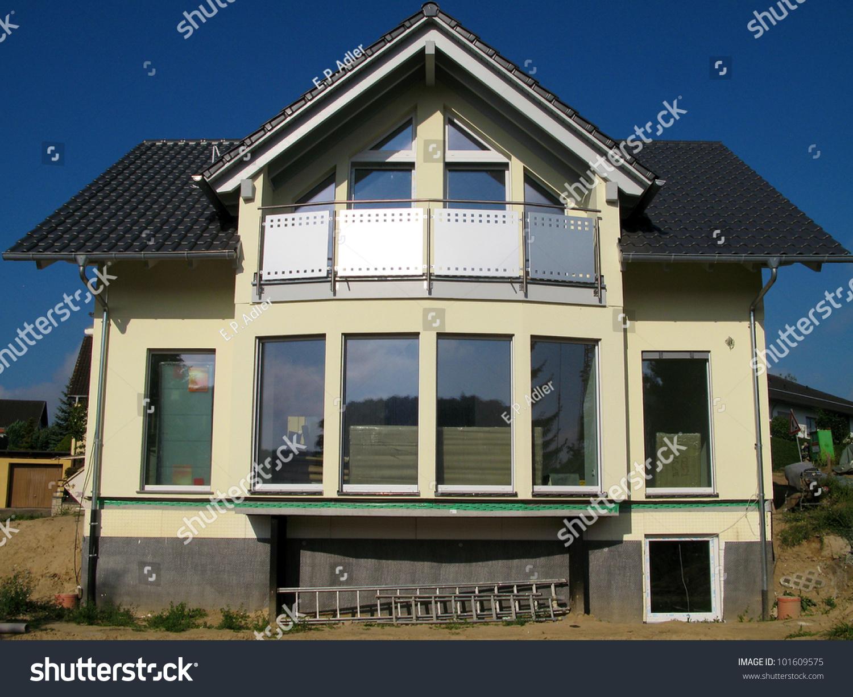 glass front modern yellow singlefamily house stock photo 101609575