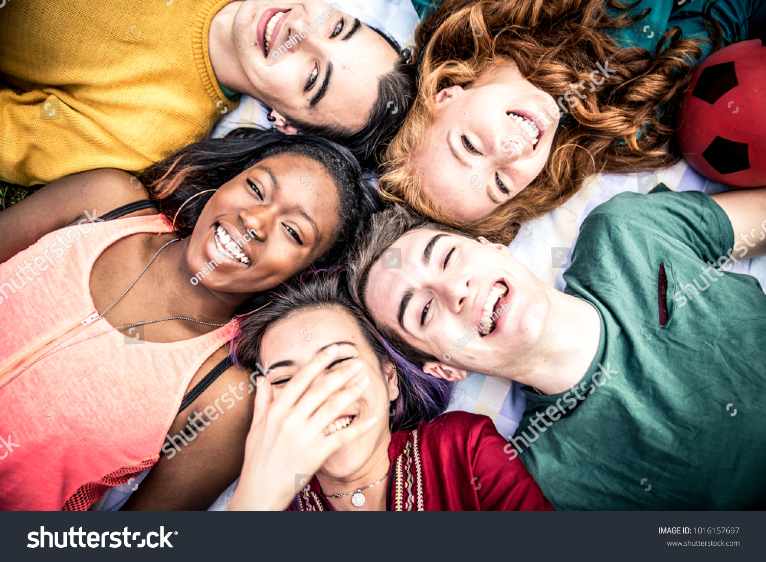 Group of  friends laughing out loud outdoor, sharing good and positive mood. #1016157697