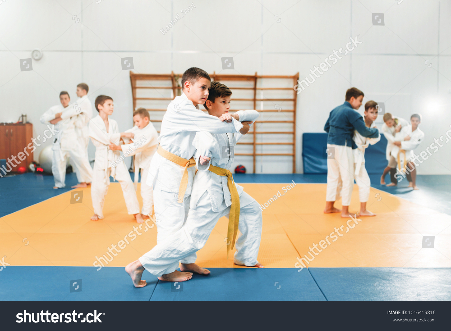 Kid judo, childrens training martial art in hall #1016419816