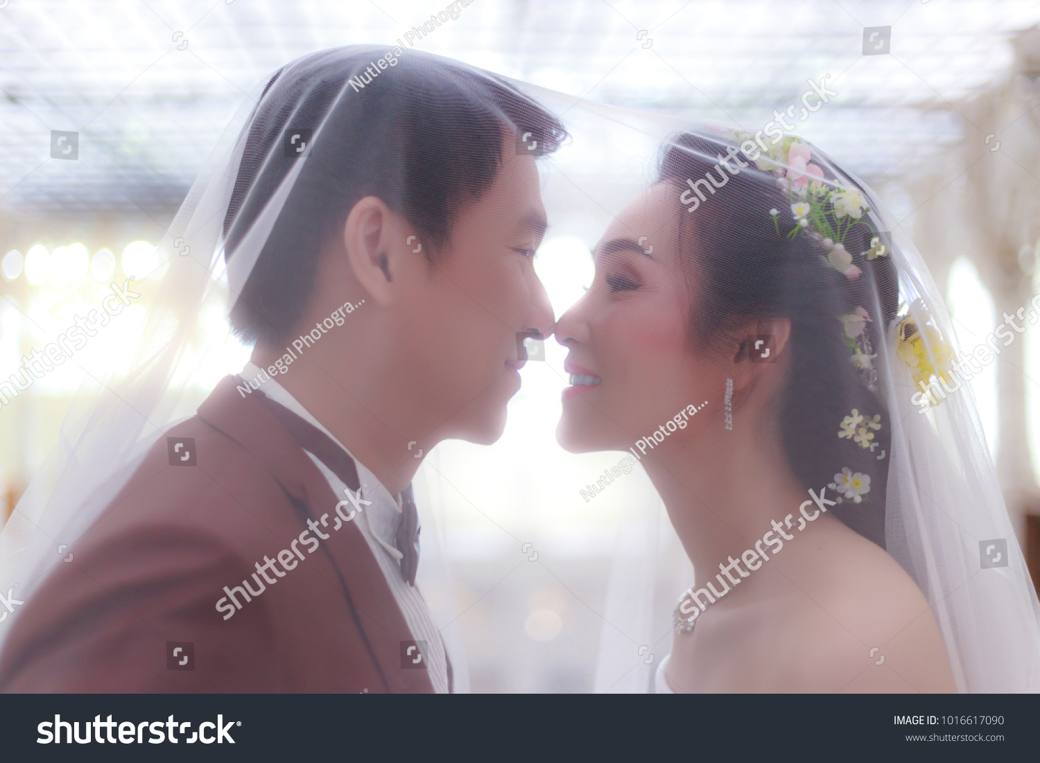 https://image.shutterstock.com/z/stock-photo-beautiful-asian-bride-get-married-with-handsome-asian-bloom-they-feel-happy-attractive-guy-is-1016617090.jpg