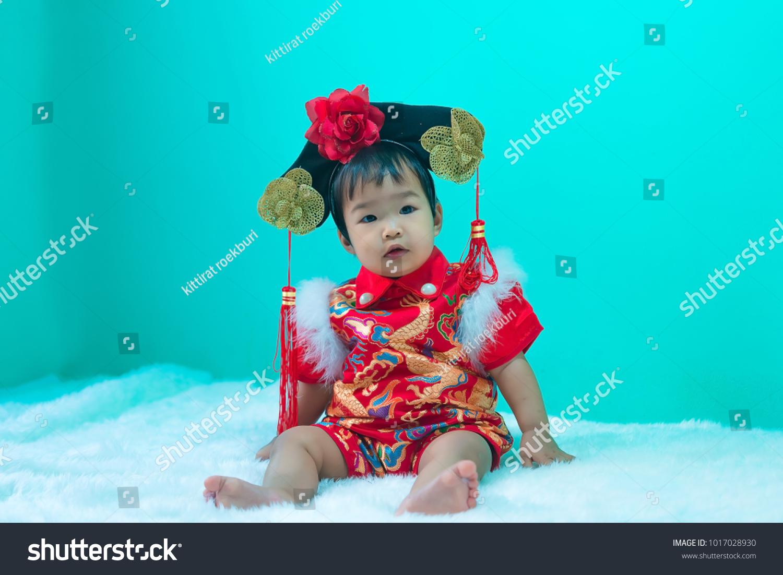 asian cute baby wear cheongsam dress happy stock photo (royalty free