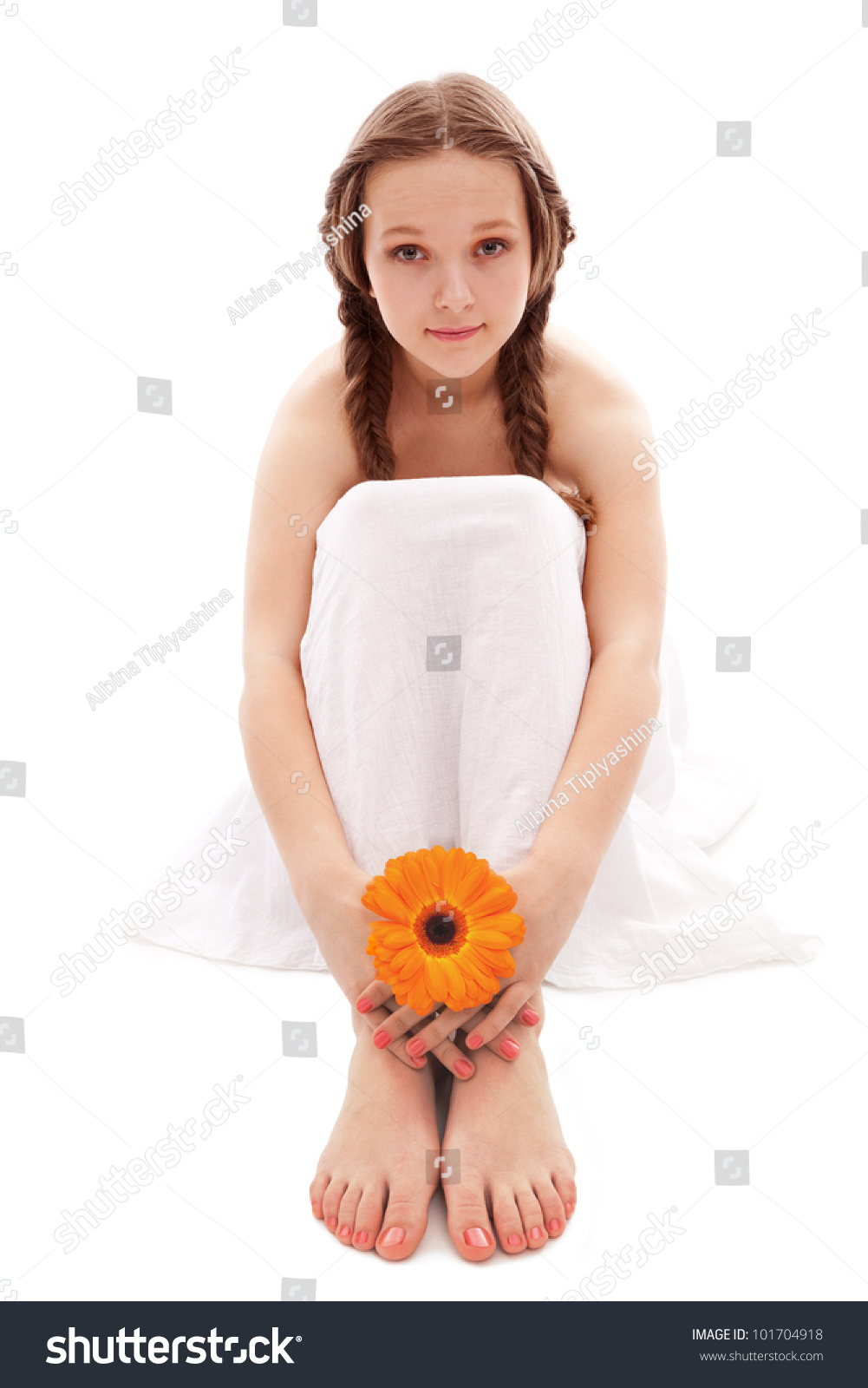 young feet young woman hand and feet with manicure and orange flower isolated on white
