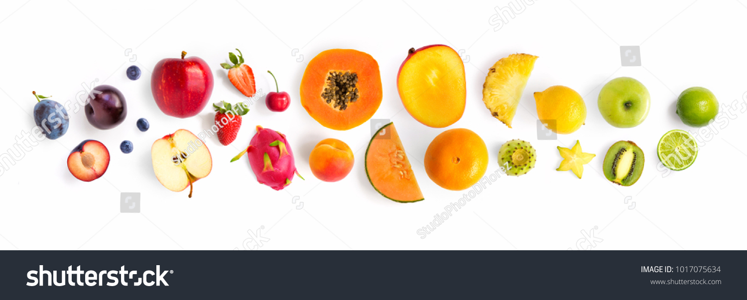 Creative layout made of fruits. Flat lay. Plum, apple, strawberry, blueberry, papaya, pineapple, lemon, orange, lime, kiwi, melon, apricot, pitaya and carambola on the white background.